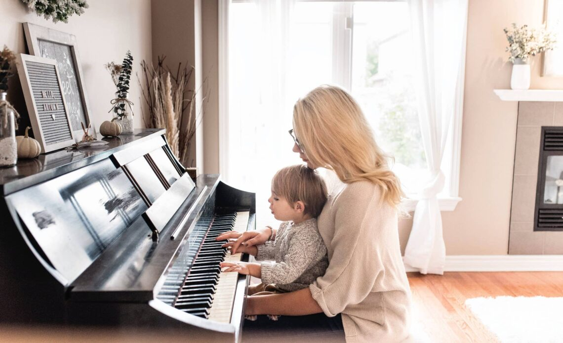 Mother and baby at the piano