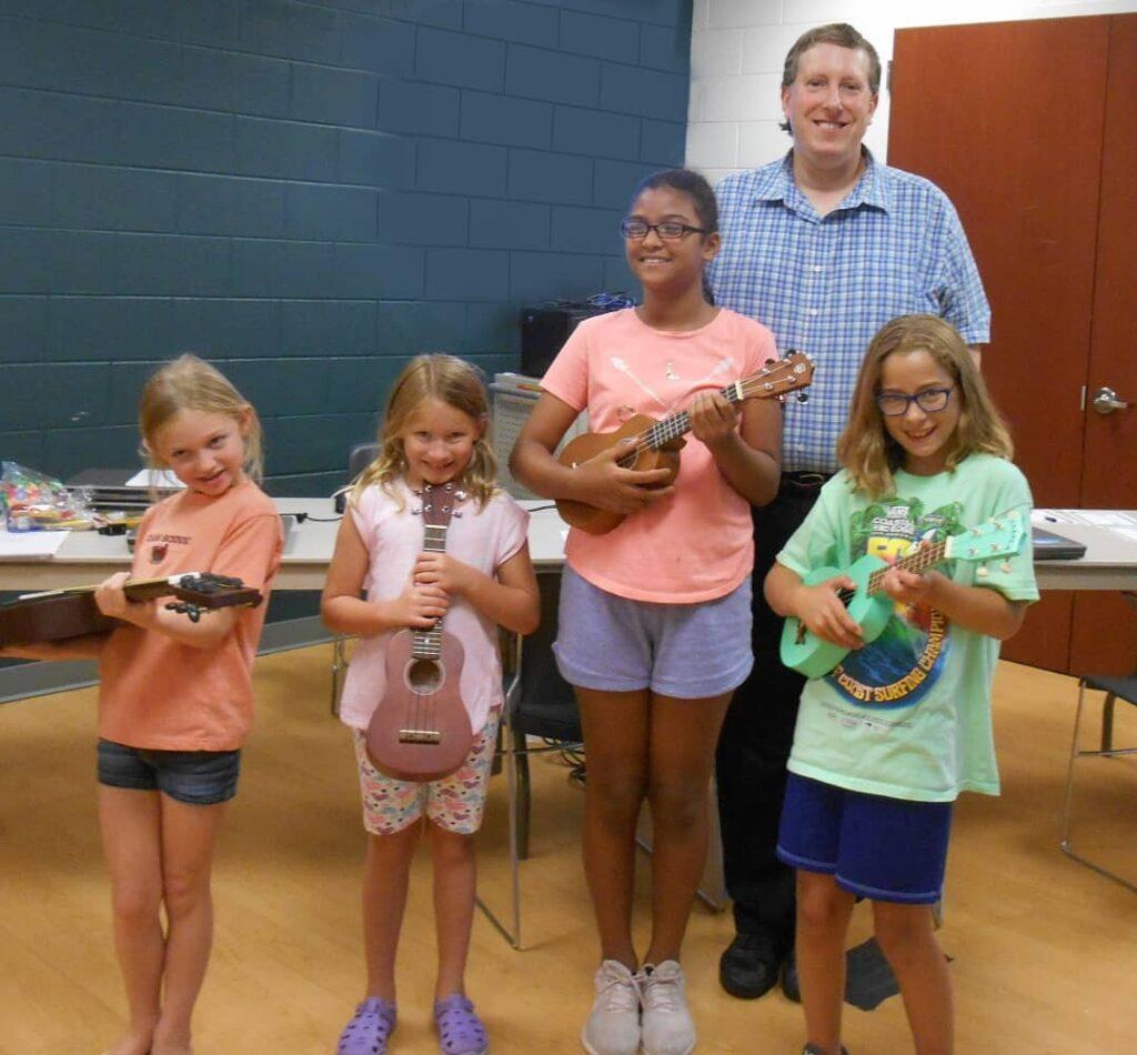 Jamie at school teaching 4 kids